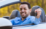 Man in Convertible Car with Keys