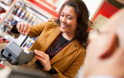 Woman Using a Debit Card at a Store