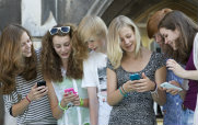 Group of Young Women Using Smartphones and Talking