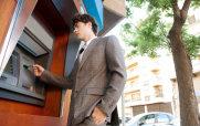 Man Using an ATM Machine