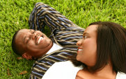 Man and Woman Laying in the Grass Laughing